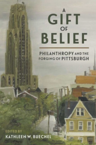 """Cover of """"Gift of Belief"""" book. It is a painting of the tall University of Pittsburgh Cathedral of Learning building behind a row of two-story houses and trees."""